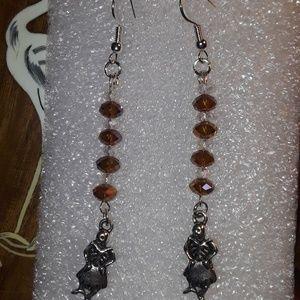 Jewelry - Dancing Skeleton in skirt earrings,  golden amber